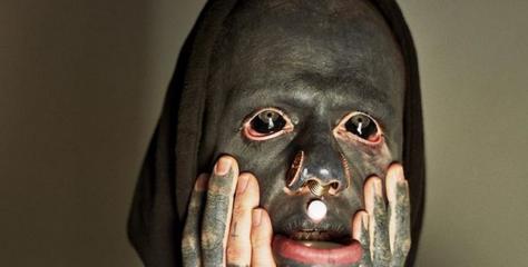 Tattoo addict inks entire body including eyeballs, inside mouth